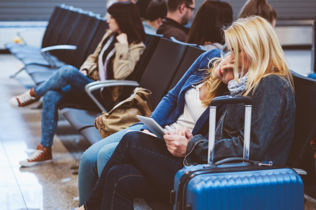 two women sleeping in an airport