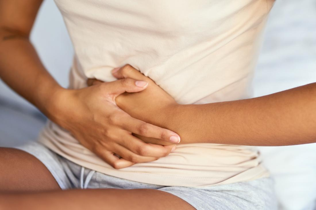 Woman Upper Stomach Pain