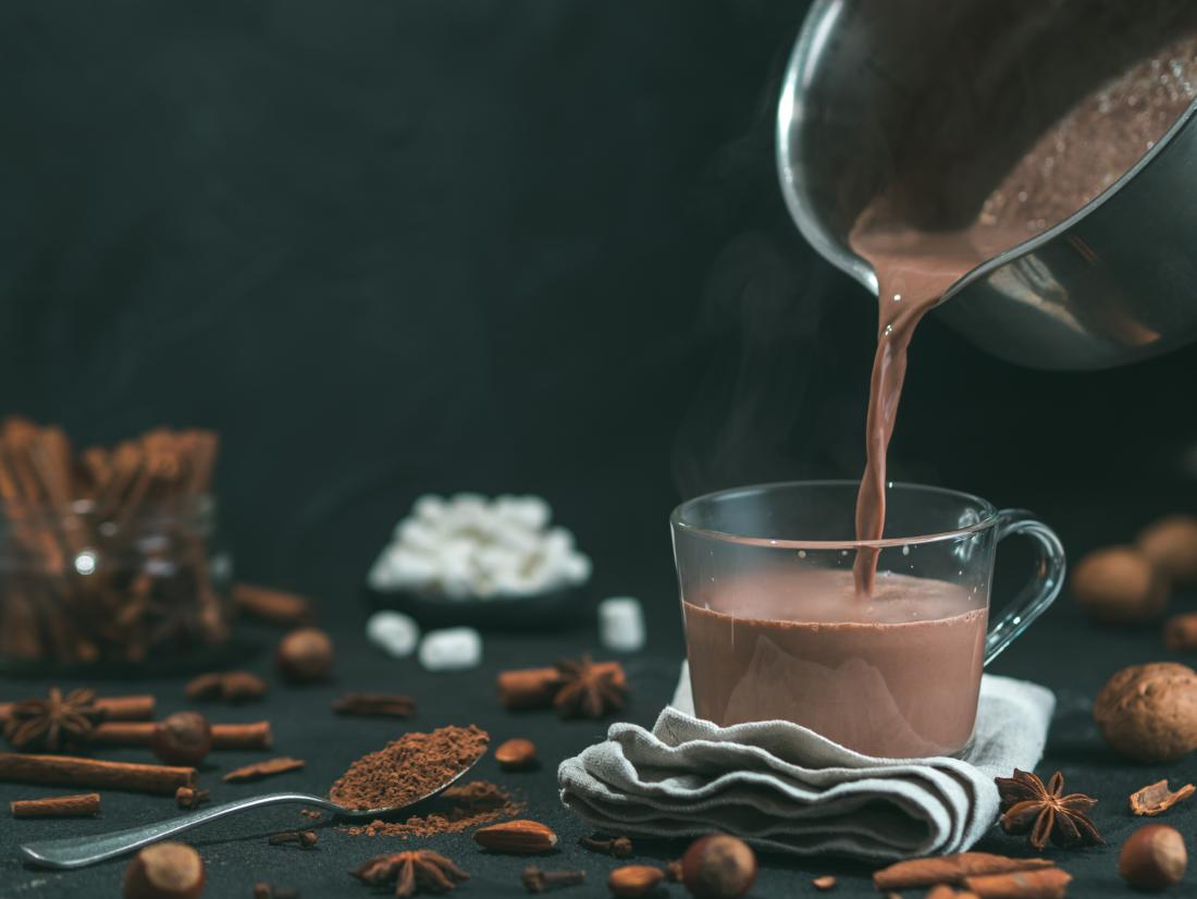 delicious-looking cocoa drink being poured in a glass