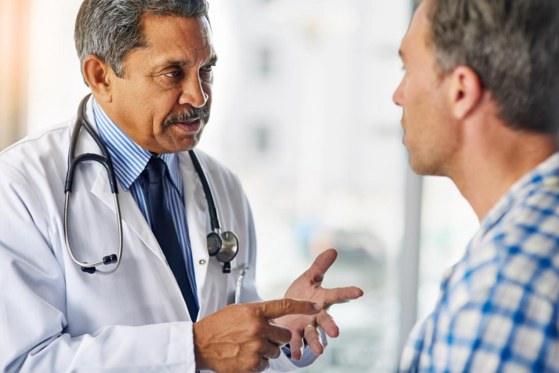 doctor giving advice to a patient