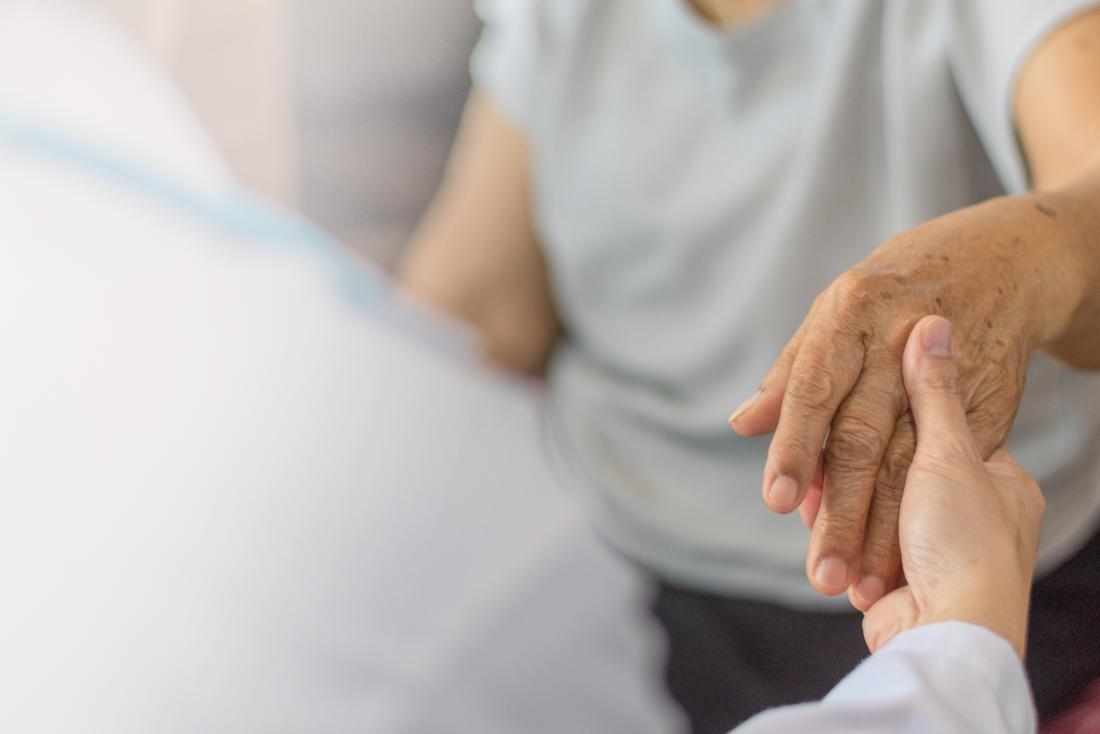 Older adult holding hands