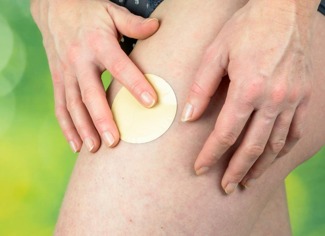 Nicotine patch being placed on a leg which may help with ulcerative colitis