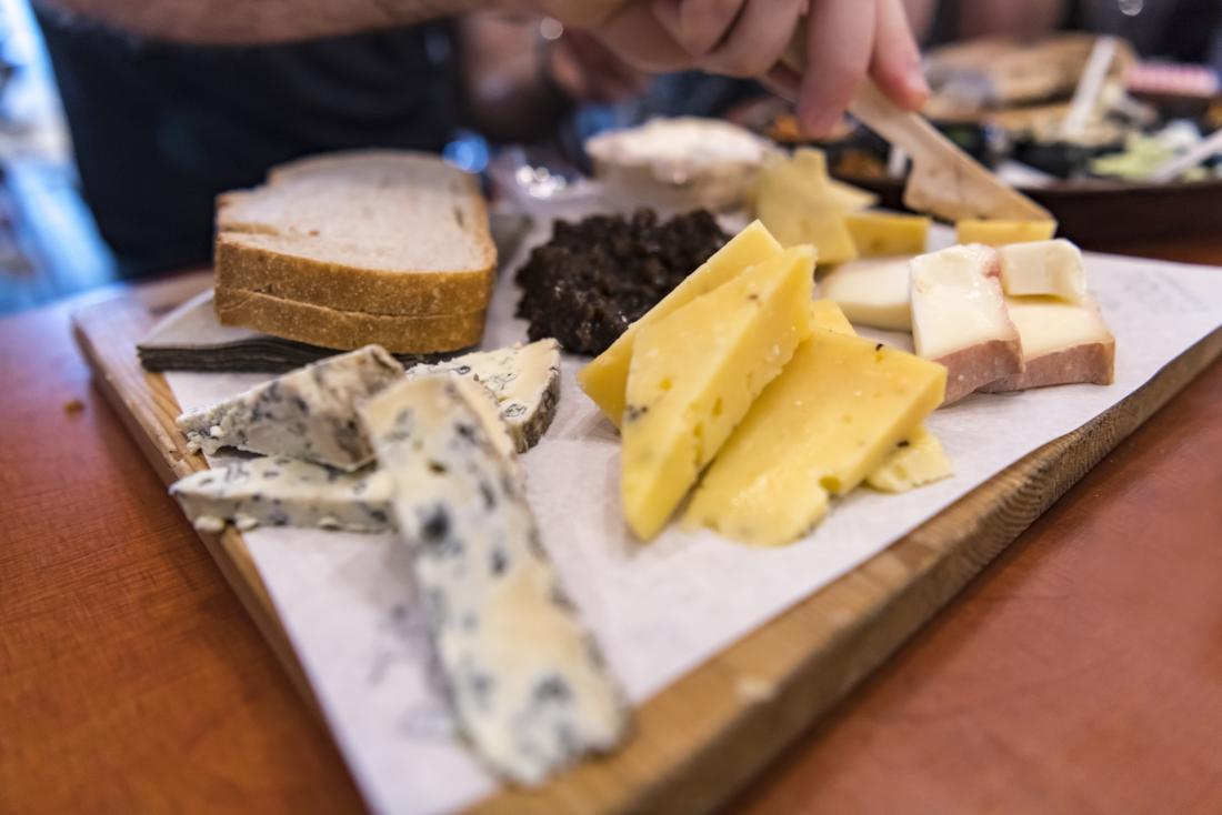 Various cheeses on a board which are part of hypothyroidism diet