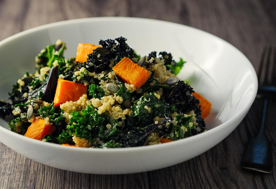 Sweet potato, kale and quinoa salad with dark leafy greens and vitamin a for skin