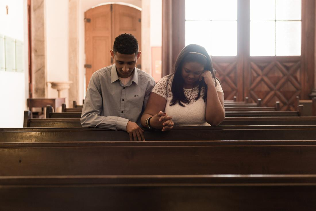 young couple praying
