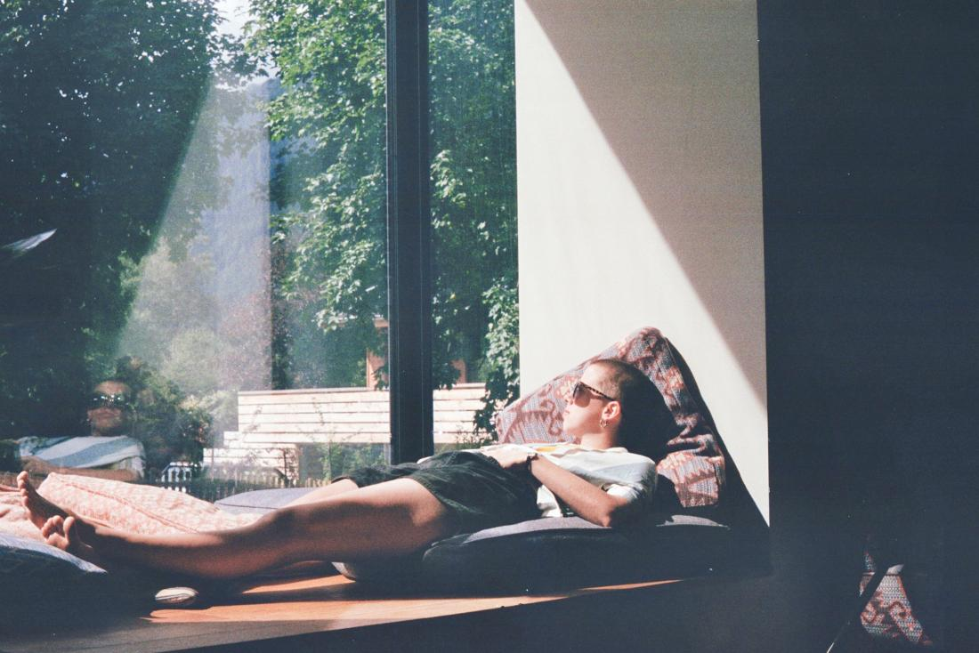 person relaxing by a window
