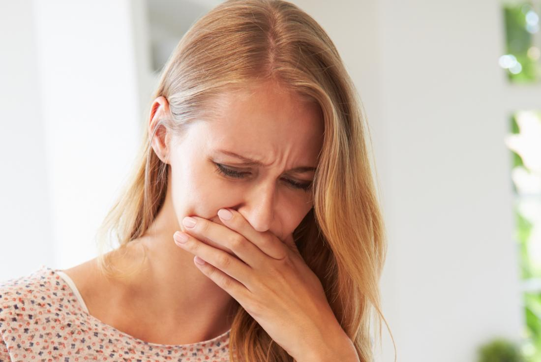 Woman feeling sick and nauseous because she accidentally ate maggots