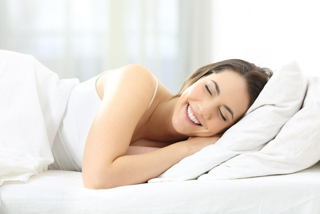 Woman laughing in sleep