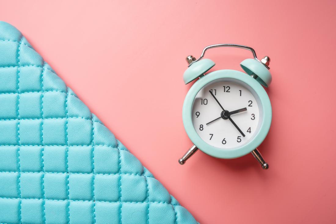 blue clock on a pink background