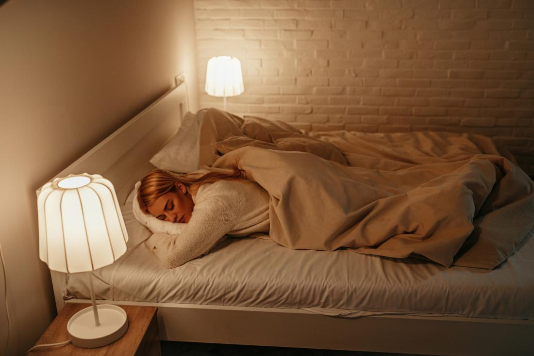 Woman sleeping with lights on