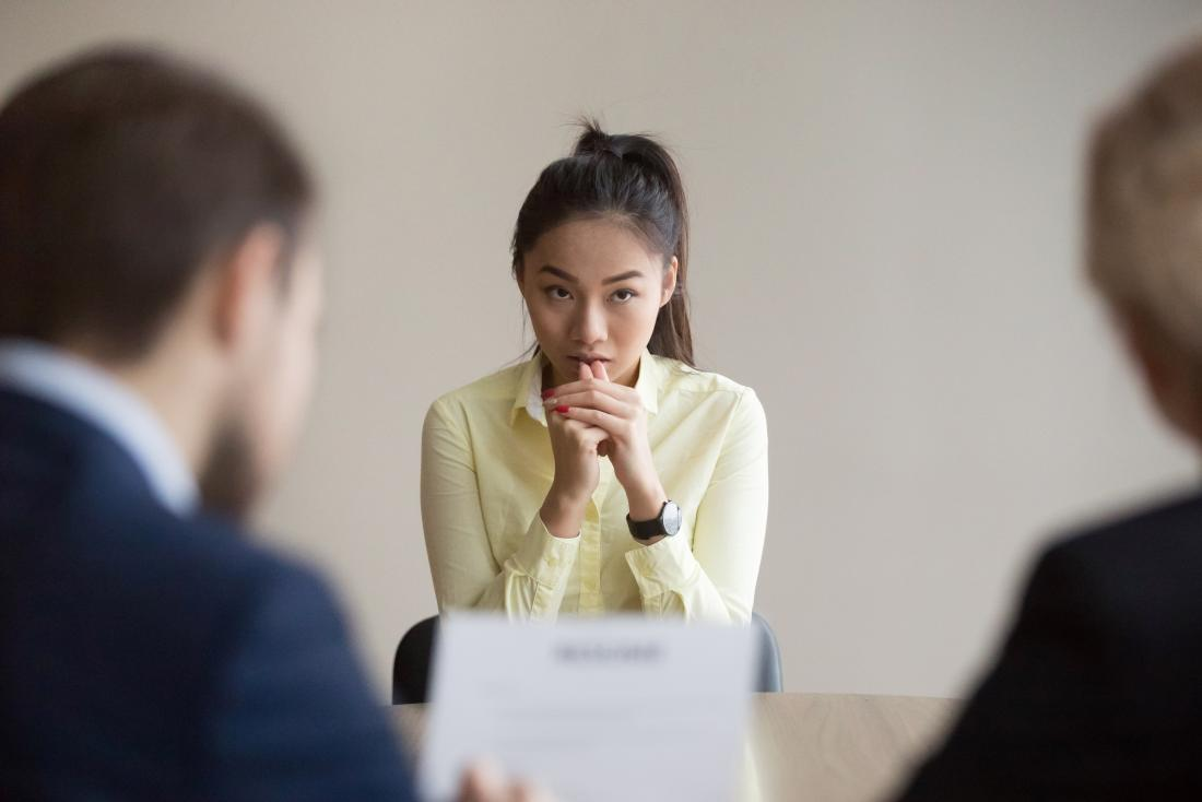 young woman looking nervous at interview