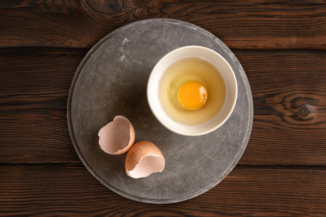 Eating raw eggs is not recommended because they may contain bacteria that causes illness.