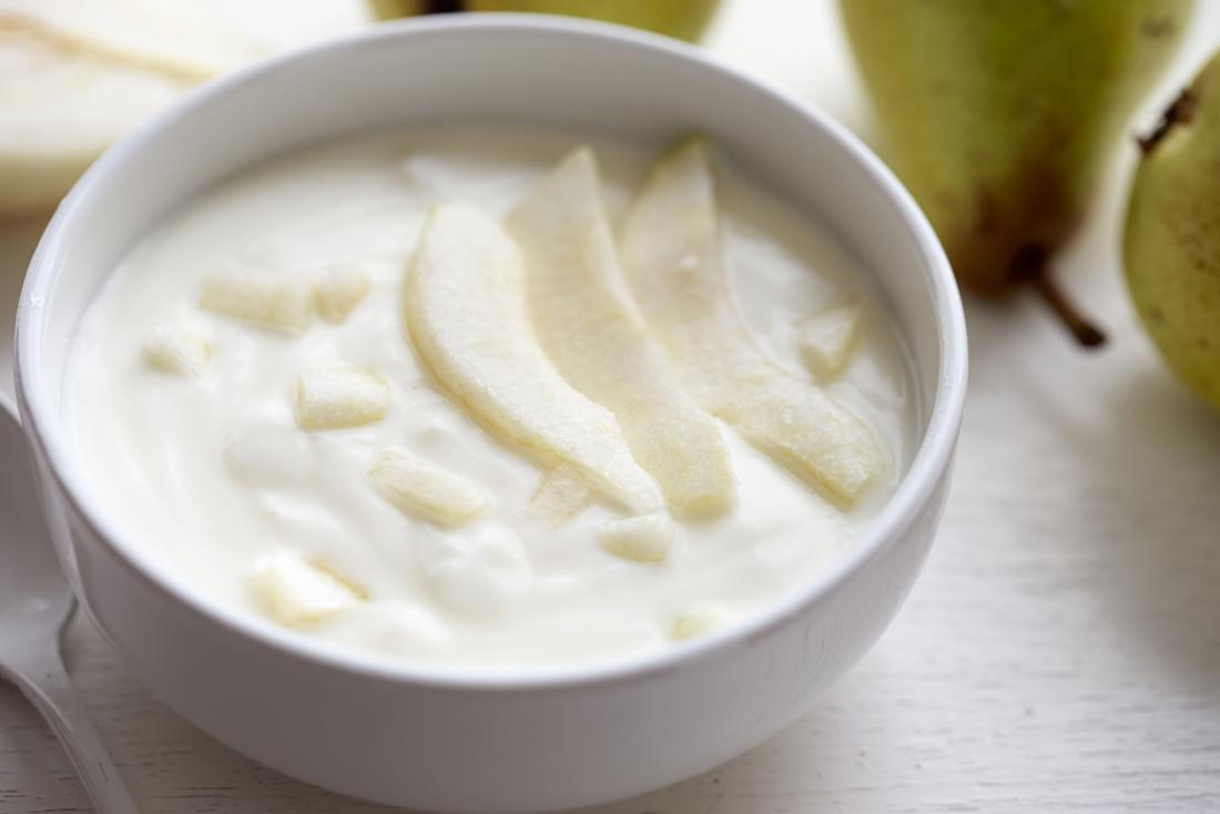 A bowl of yogurt and pear.