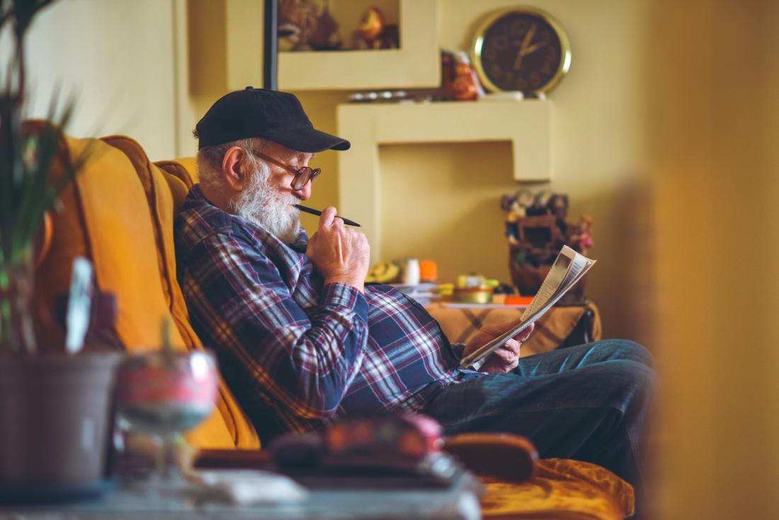 Older adult doing crossword