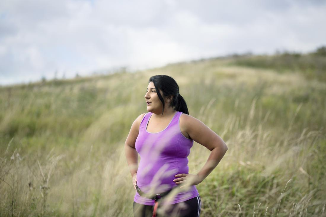 a woman pictured in a field after running
