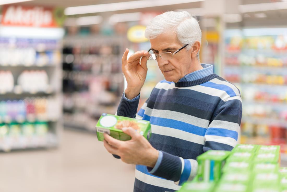 a man in a supermarket looking at some food wondering where what its score is on the glycemic index