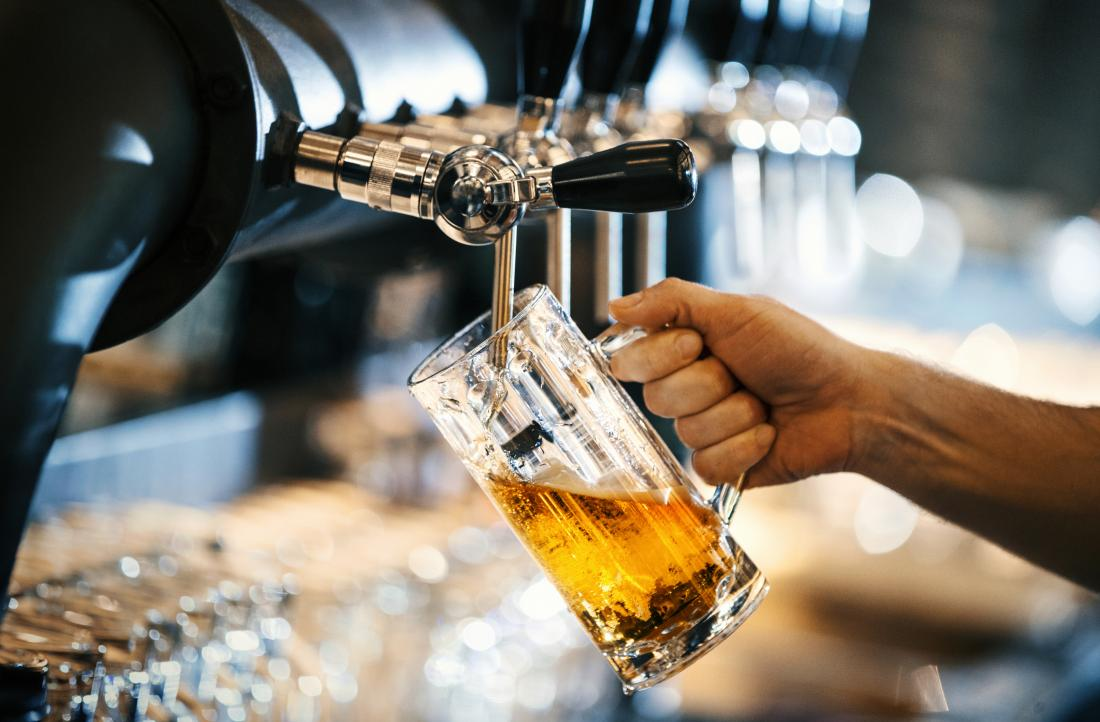 A pint of beer being poured which may cause bloating