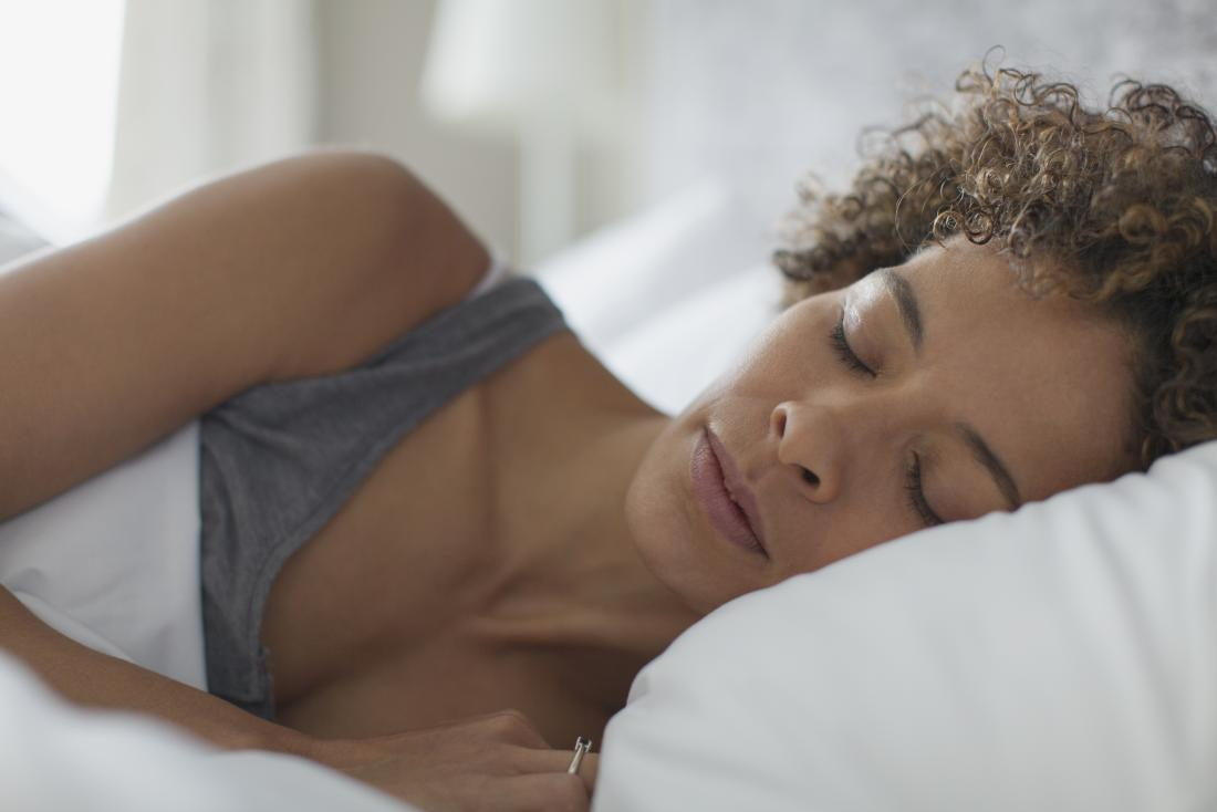 A woman sleeping as a way to improve digestion