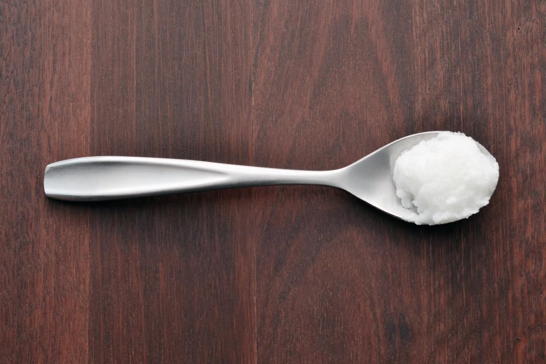 a spoon with coconut oil on it.
