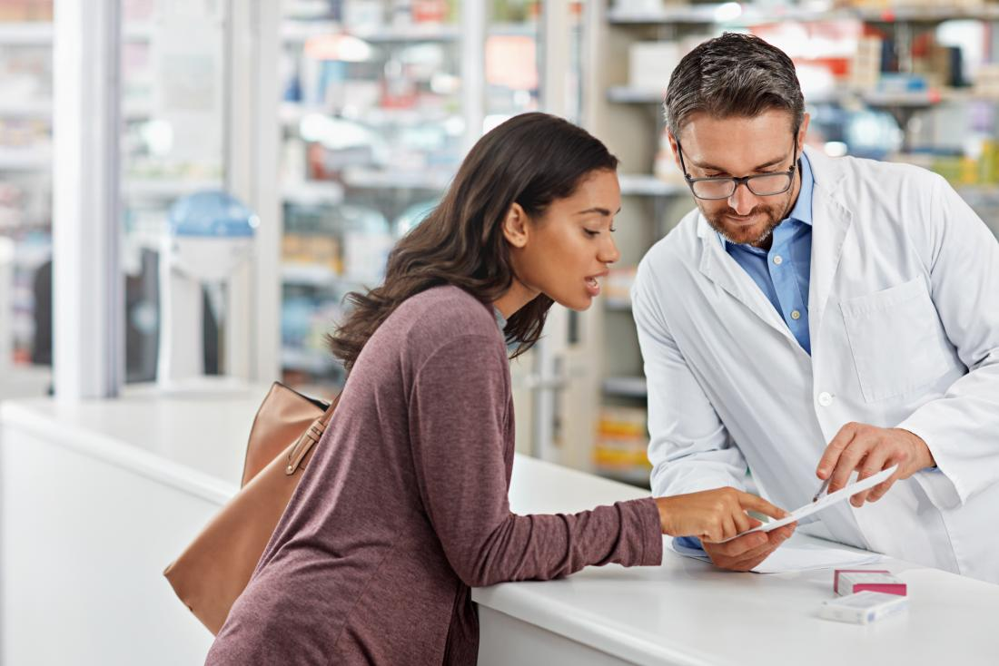 woman with asthma discusses her nebulizer prescription over counter with pharmacist