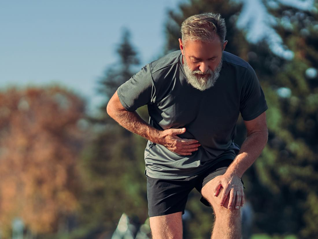 a man exercising outside who has a Pulled stomach muscle