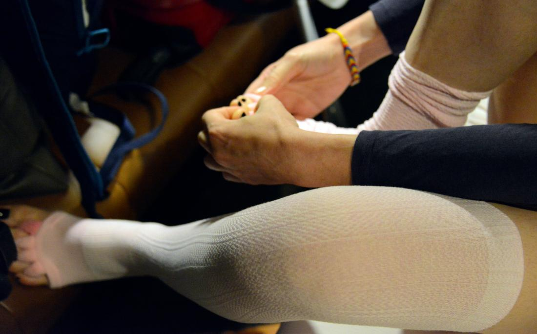 a woman putting on Compression stockings
