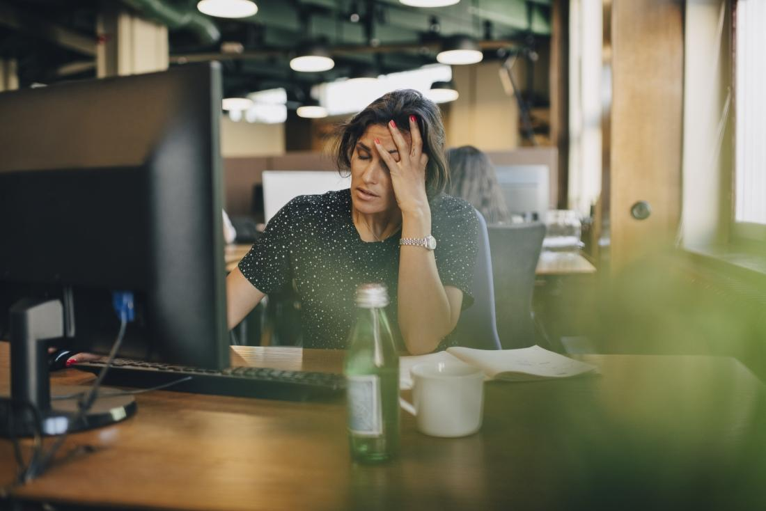 person feeling stressed and overwhelmed at work