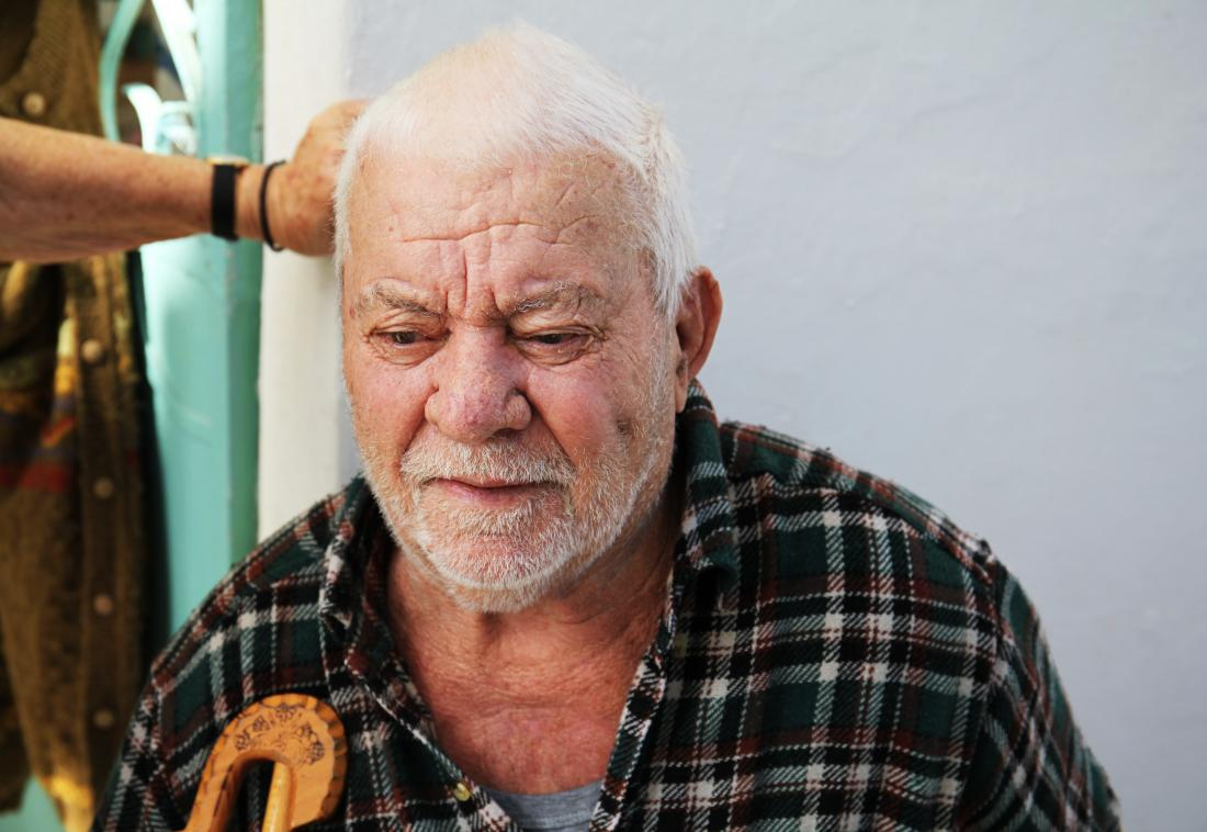 image of older man looking down