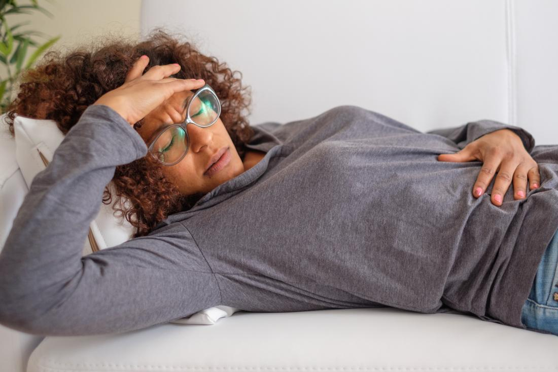 A woman experiencing nausea from Birth control