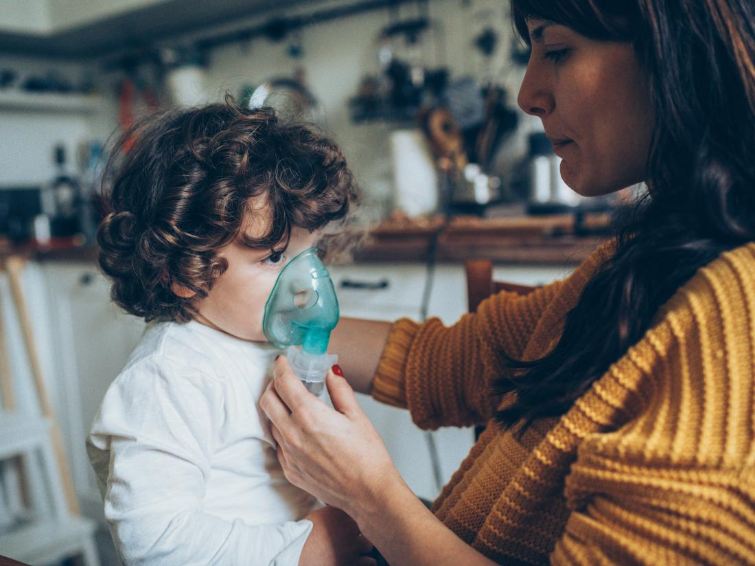 A woman helping with Cystic fibrosis in children