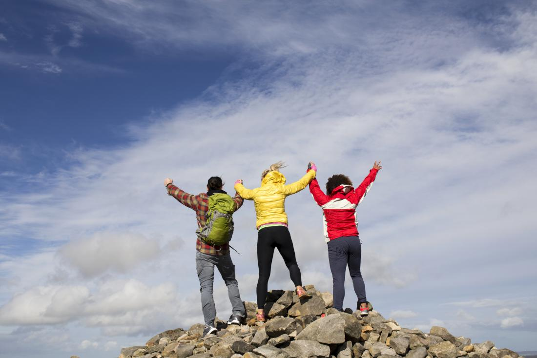 3 people on top of a mountain