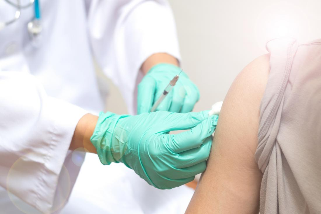 close up of doctor administering flu shot