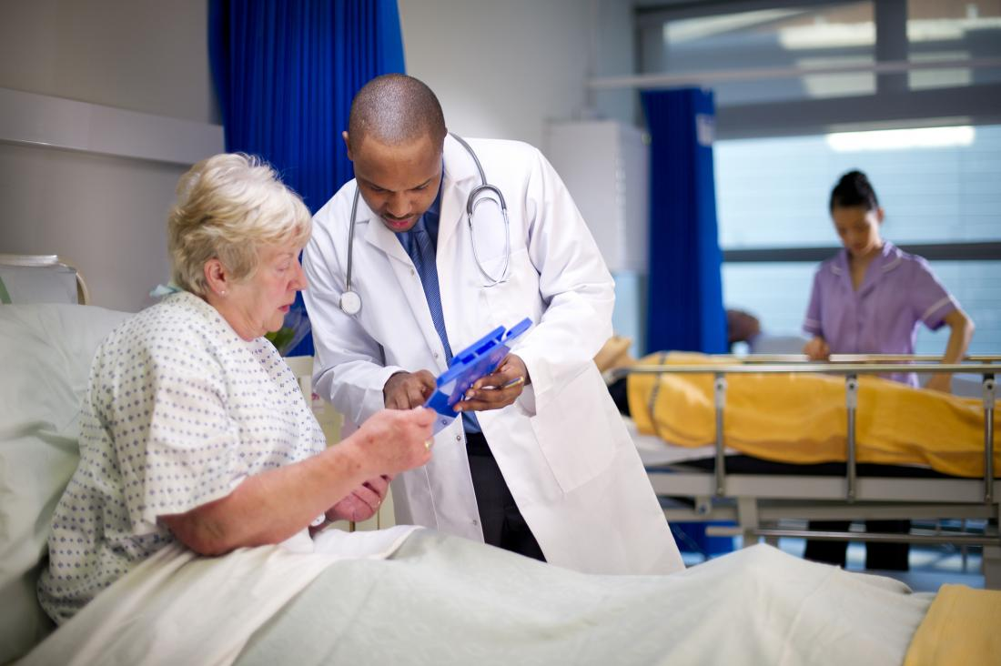 doctor advising patient in hospital
