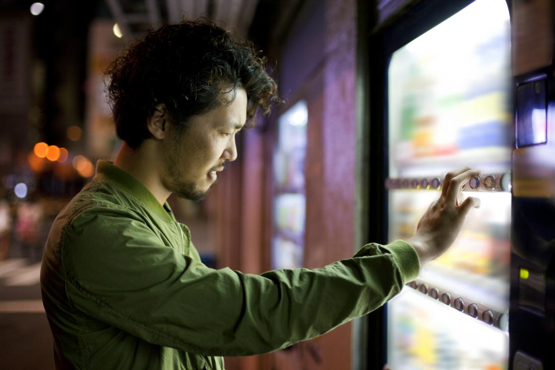 man staring at vending machine