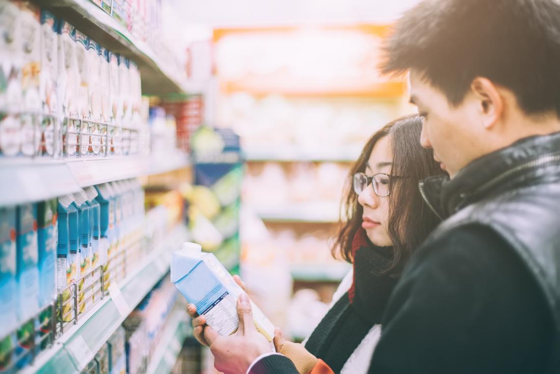 Couple buying milk and wondering if dairy is bad for you