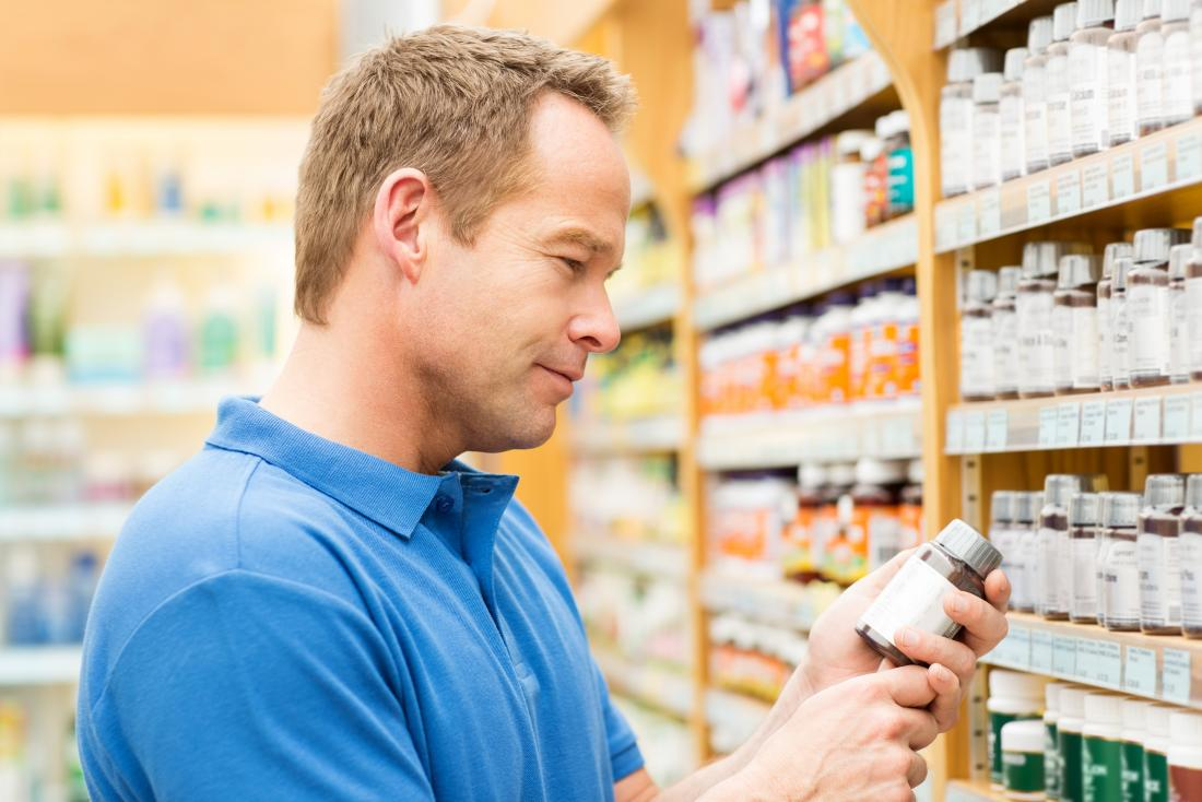 a man in a pharmacy buying the Best multivitamin for men