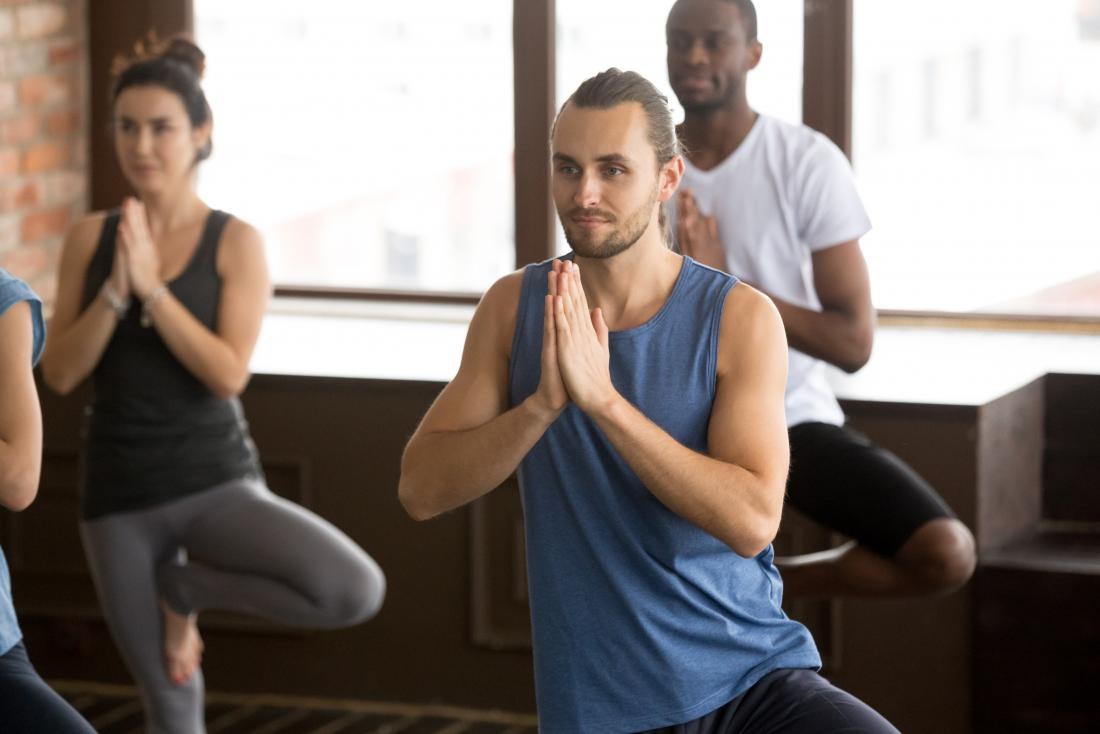 a man experiencing the benefits of group yoga