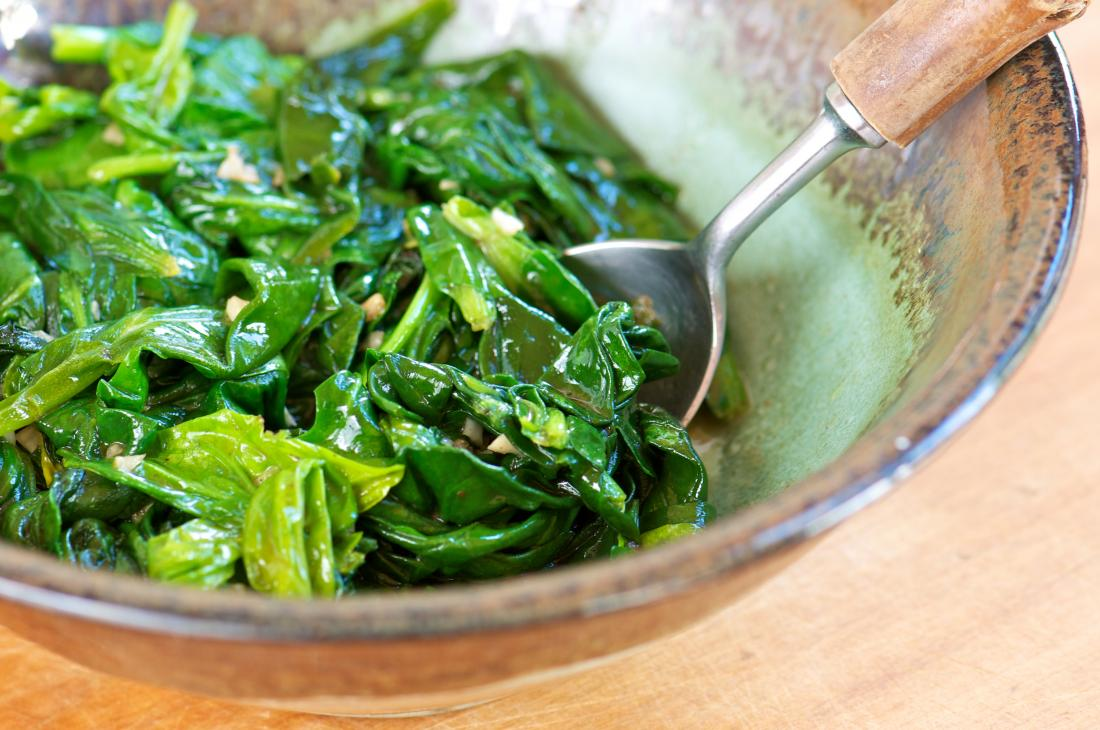 A Sauteed Spinach with Garlic in Pottery Bowl
