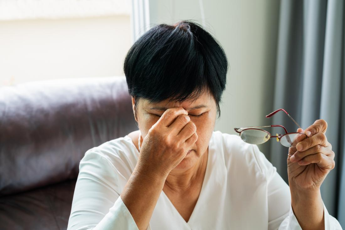 a woman with itchy eyes because she has carcinoma in situ