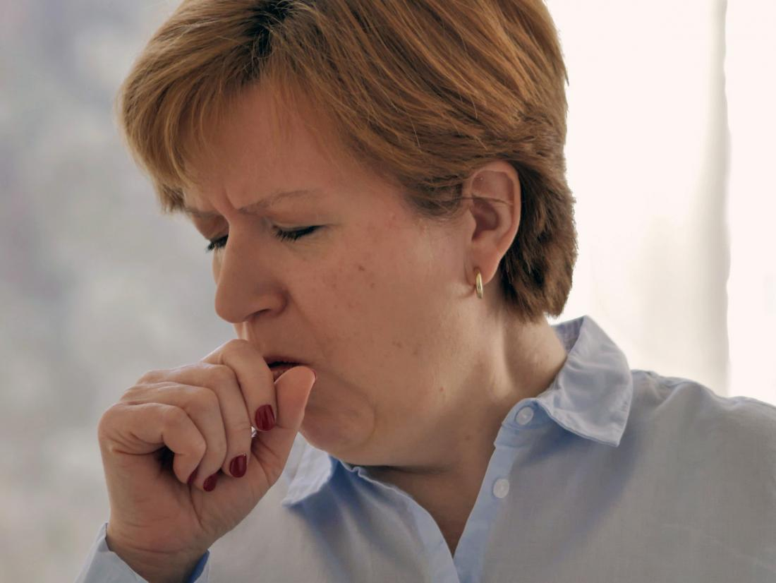 a woman with Influenza a who is coughing.