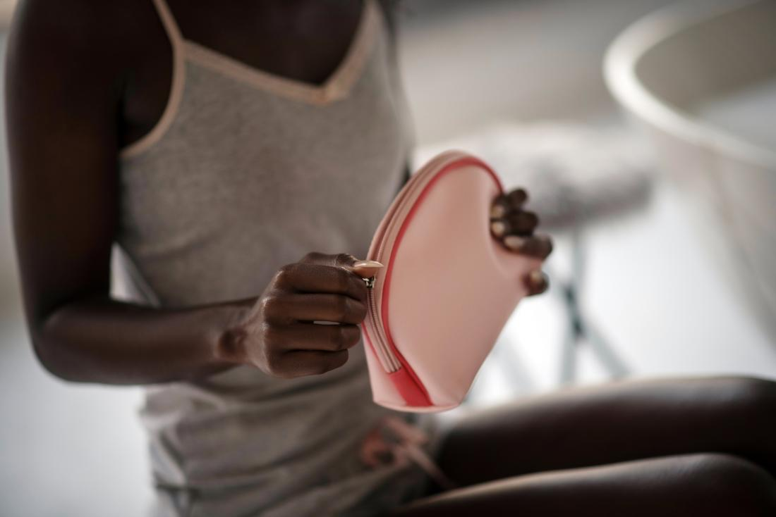 woman performing feminine hygiene routine