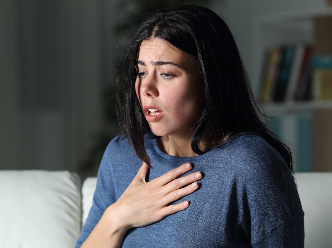 a woman experiencing shortness of breath because of anxiety
