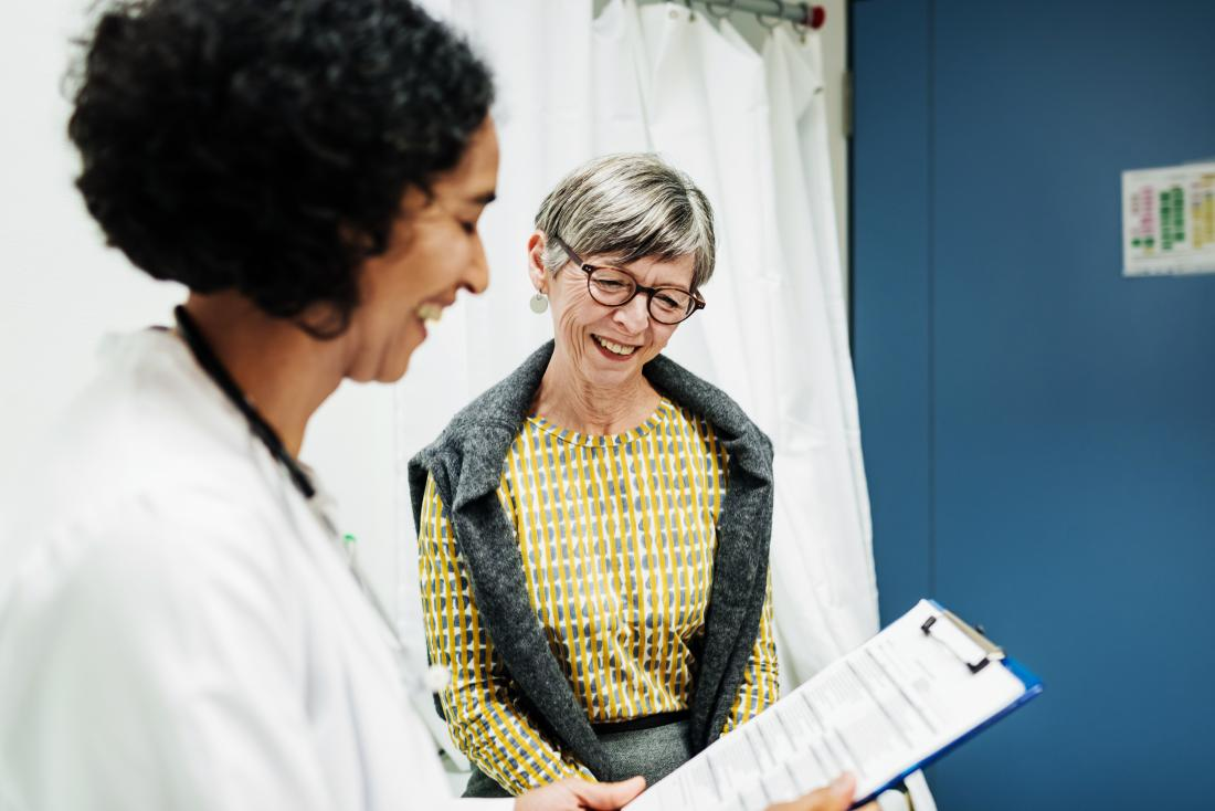 female patient with doctor discussing triple negative breast cancer recurrence and survival rates in office