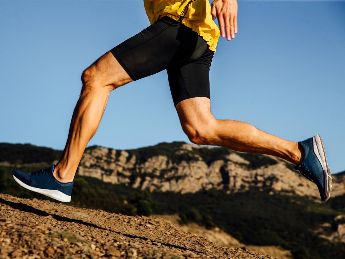 a view of a male runners legs where both the Tendons and ligaments are getting engaged.