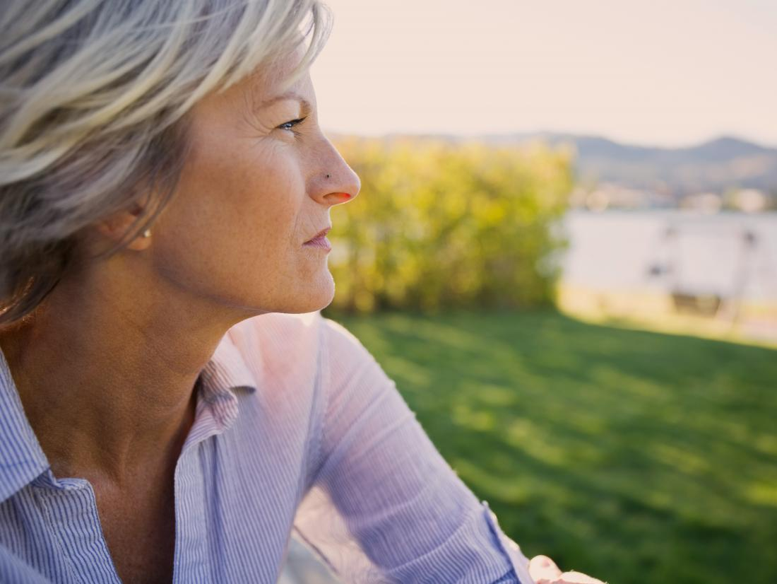 a woman looking pensive as she thinks about Ovarian cancer Stages