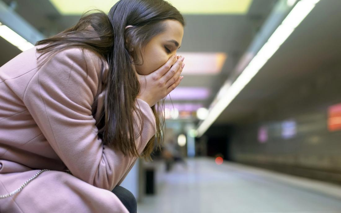 a woman experiencing shock at a subway station.
