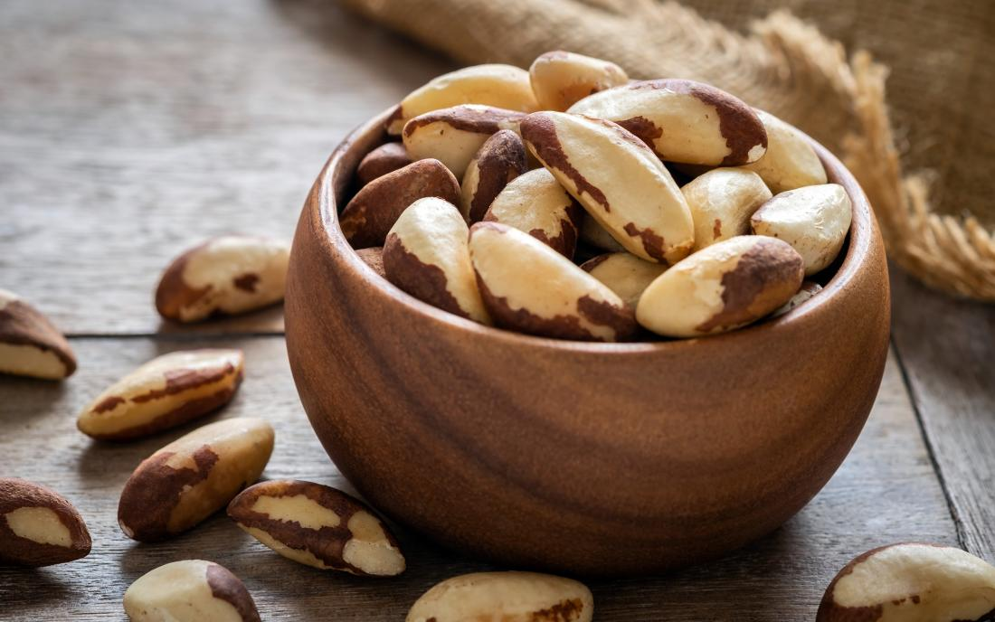 Brazil nuts in wooden bowl which may cause an allergy