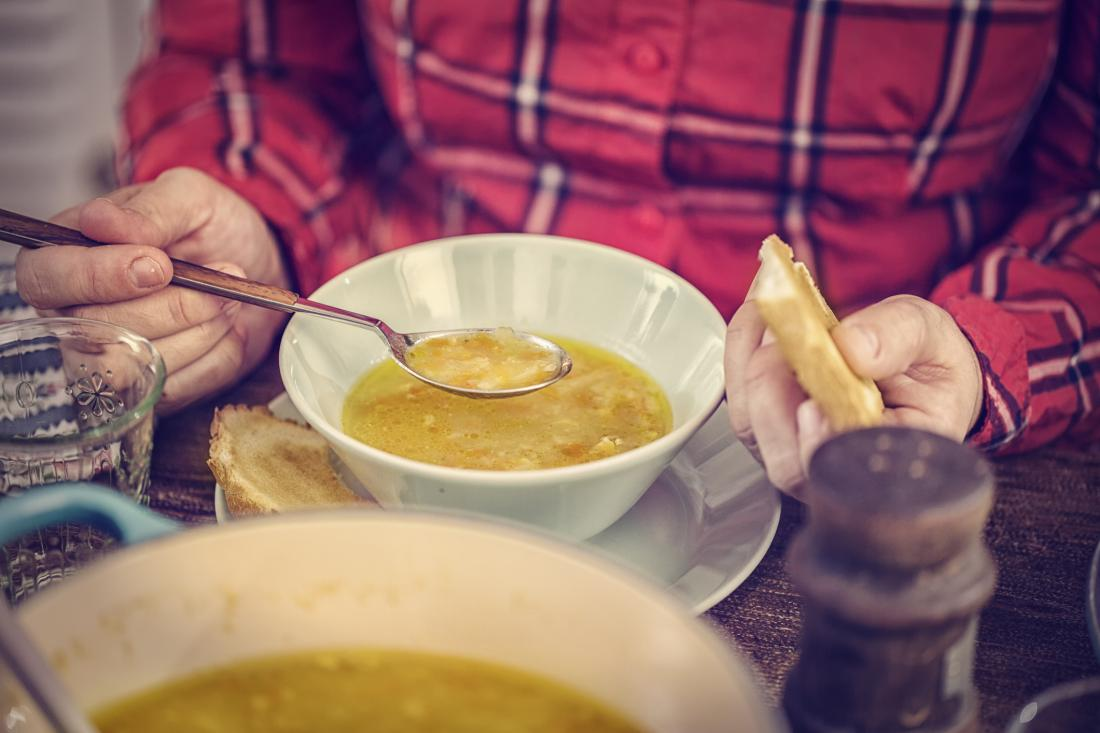 close up of man eating soup