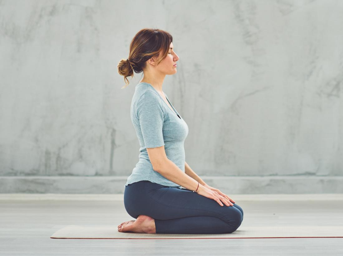 a woman doing Adamant yoga Pose
