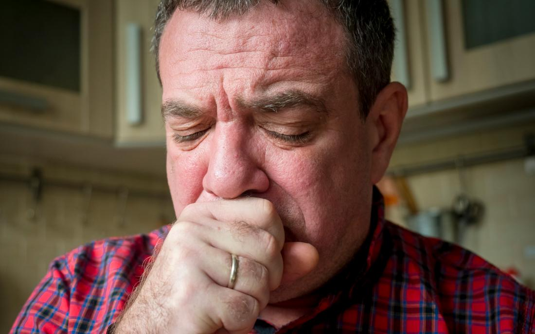 a man coughing because of bronchitis